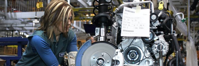 A worker builds an engine for a 2012 Ford Focus on the assembly line at the Ford Motor Co.'s Michigan Assembly Plant December 14, 2011 in Wayne, Michigan. Ford released details about the electrification of the Michigan Assembly Plant that will power production in part by one of the largest solar energy generator systems in order to produce their new C-MAX Hybrid and C-MAX Energi electric vehicles.