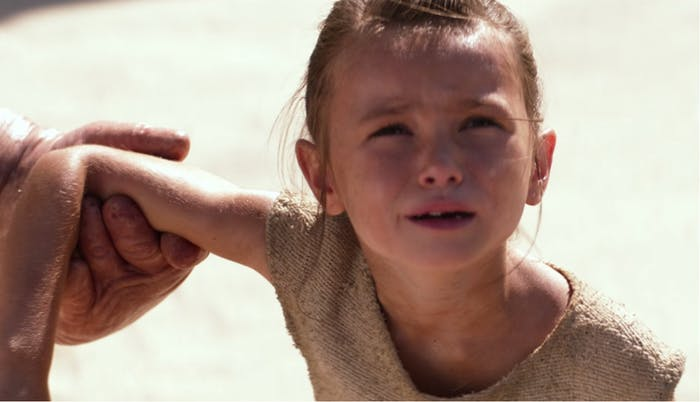 Young Rey yells at what we assume is the departing ship carrying her parents.