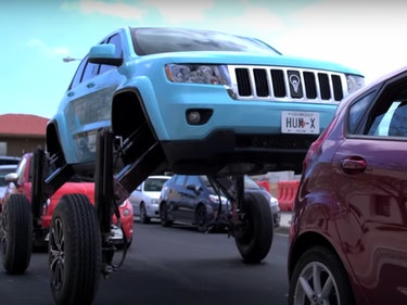 Watch This Modified SUV Drive Over Traffic in a Wild PR Stunt