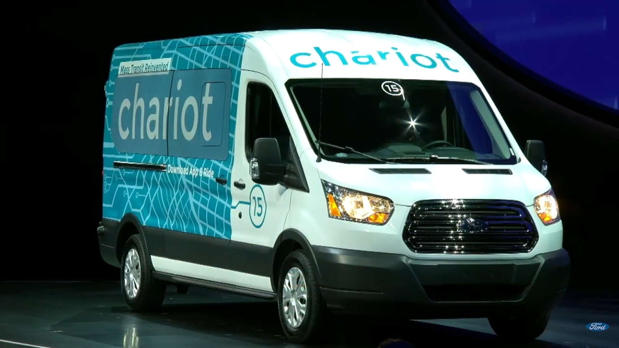 A Chariot transit van rolls onto the stage at Joe Louis Arena on Monday.