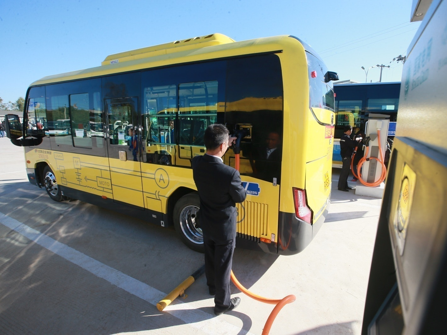 A worker charges an electric bus in Beijing, China. Researchers in Sweden just created a model that proposes the best places in the city to install chargers for electric buses.