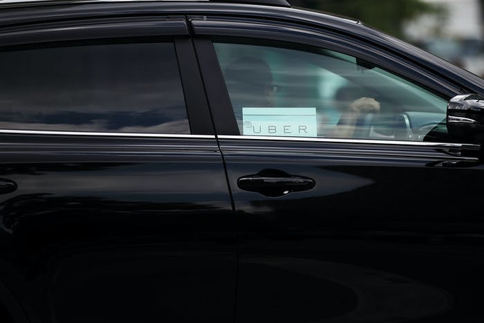 A human driving an Uber car.