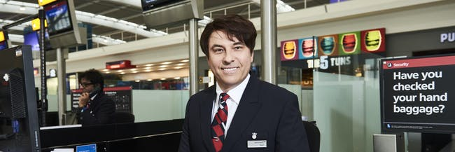LONDON, ENGLAND - MARCH 15:  In this image released by British Airways today, March 15th 2017, in London, England, David Walliams checks-in British Airways passengers at Heathrow T5 as part of the airlines Red Nose Day campaign, which launches today. David was joined by Emma Bunton and Tom Daley who also dressed as British Airways staff to surprise customers for Red Nose Day, which takes place on March 24. The airline has raised more than £15 million for the charity over the past seven years. The films can be viewed at youtube.com/britishairways. (Photo by Gareth Cattermole/Getty Images for British Airways)