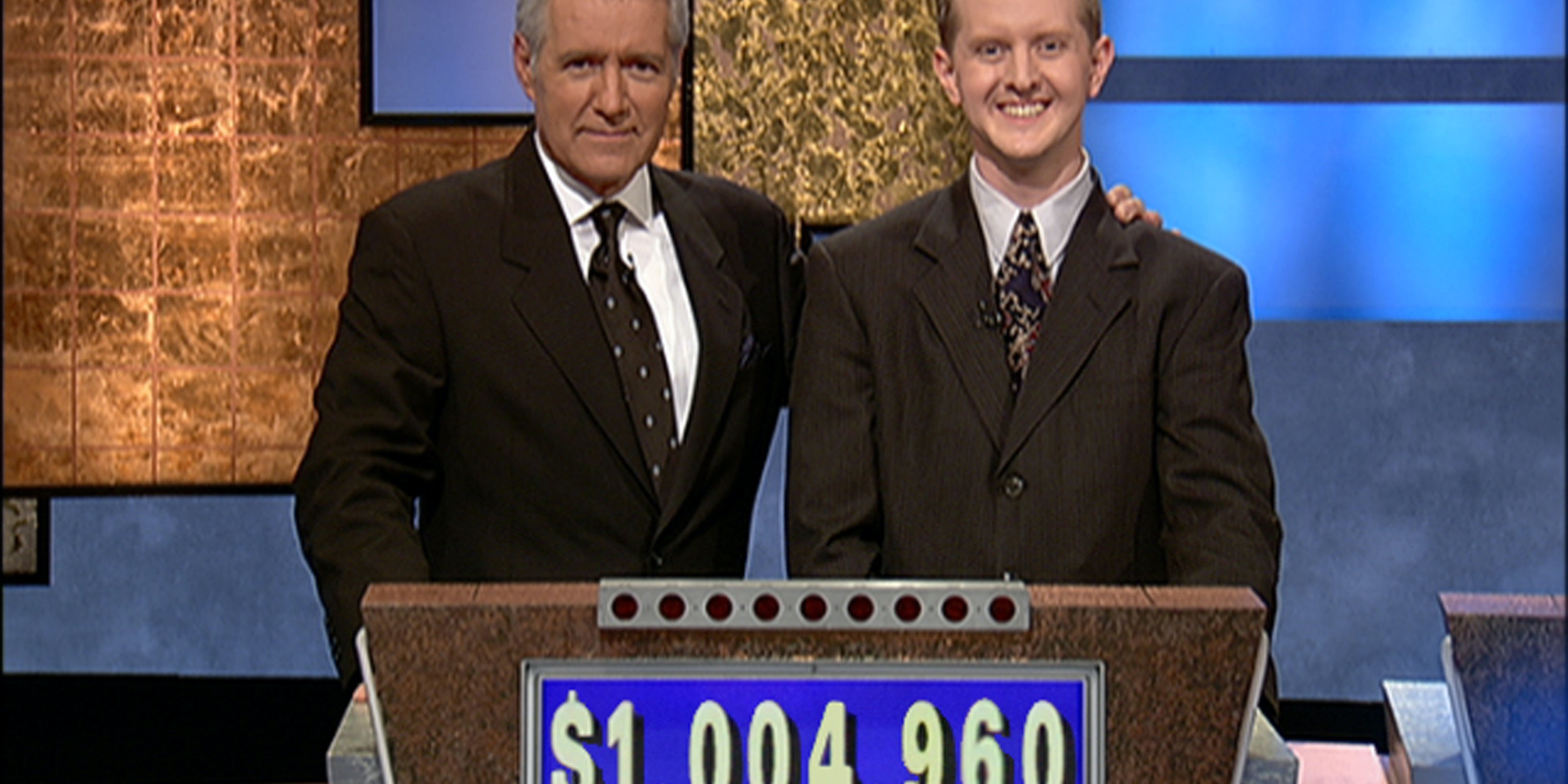 CULVER CITY, CA - JULY 14:  Jeopardy host Alex Trebek, (L) poses contestant Ken Jennings after his earnings from his record breaking streak on the gameshow surpassed 1 million dollars July 14, 2004 in Culver City, California.  (Photo by Jeopardy Productions via Getty Images)