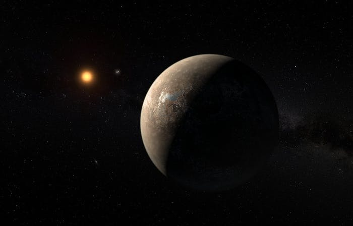 Artist's impression shows the planet Proxima b orbiting the red dwarf star Proxima Centauri, the closest star to the Solar System.
