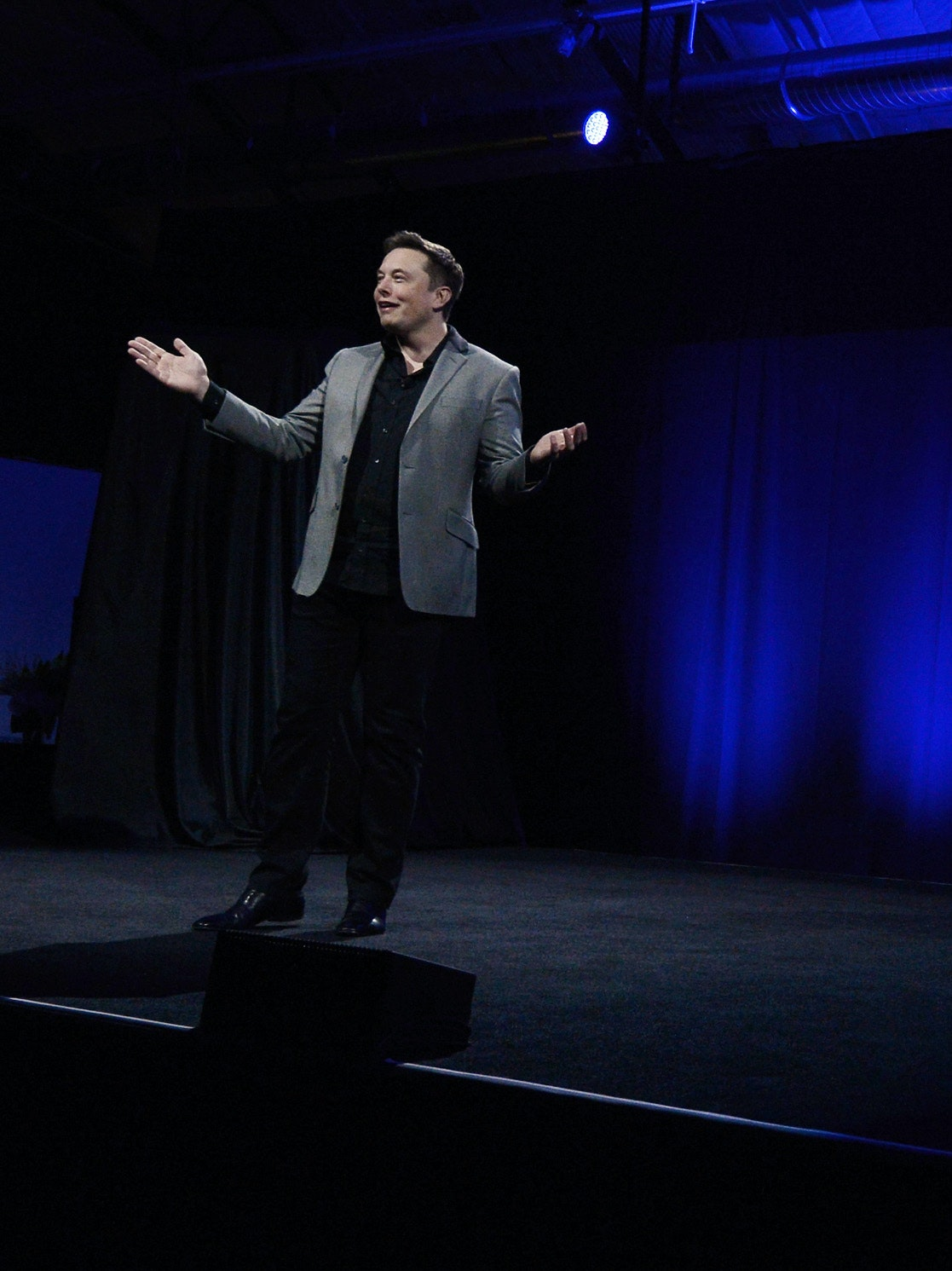 LOS ANGELES, CA - APRIL 30:  Elon Musk, CEO of Tesla, with a Powerwall system on display unveils suite of batteries for homes, businesses, and utilities at the Tesla Design Studio April 30, 2015 in Hawthorne, California. Musk unveiled the home battery named Powerwall with a selling price of $3500 for 10kWh and $3000 for 7kWh and very large utility pack called Powerpack. (Photo by Kevork Djansezian/Getty Images)