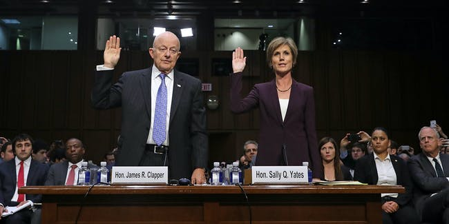 WASHINGTON, DC - MAY 08:  Former Director of National Intelligence James Clapper (L) and former acting U.S. Attorney General Sally Yates are sworn in before testifying to the Senate Judiciary Committee's Subcommittee on Crime and Terrorism in the Hart Senate Office Building on Capitol Hill May 8, 2017 in Washington, DC. Before being fired by U.S. President Donald Trump, Yates had warned the White House about contacts between former National Security Advisor Michael Flynn and Russia that might make him vulnerable to blackmail.  (Photo by Chip Somodevilla/Getty Images)
