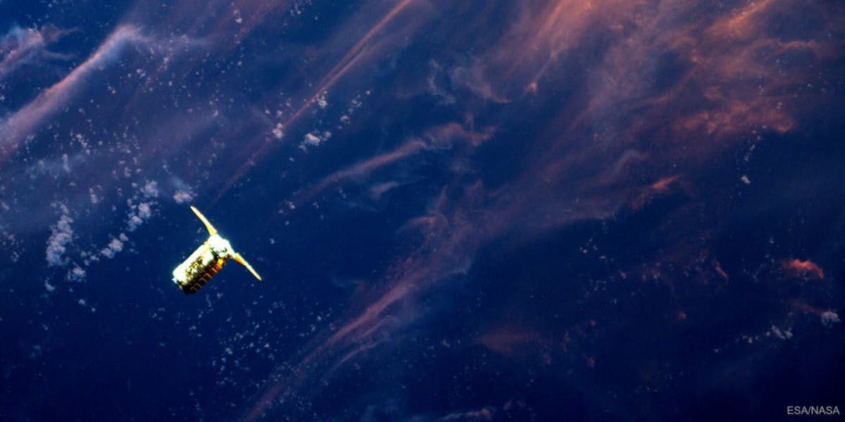 A photo from the International Space Station shows the Cygnus supply ship approaching.