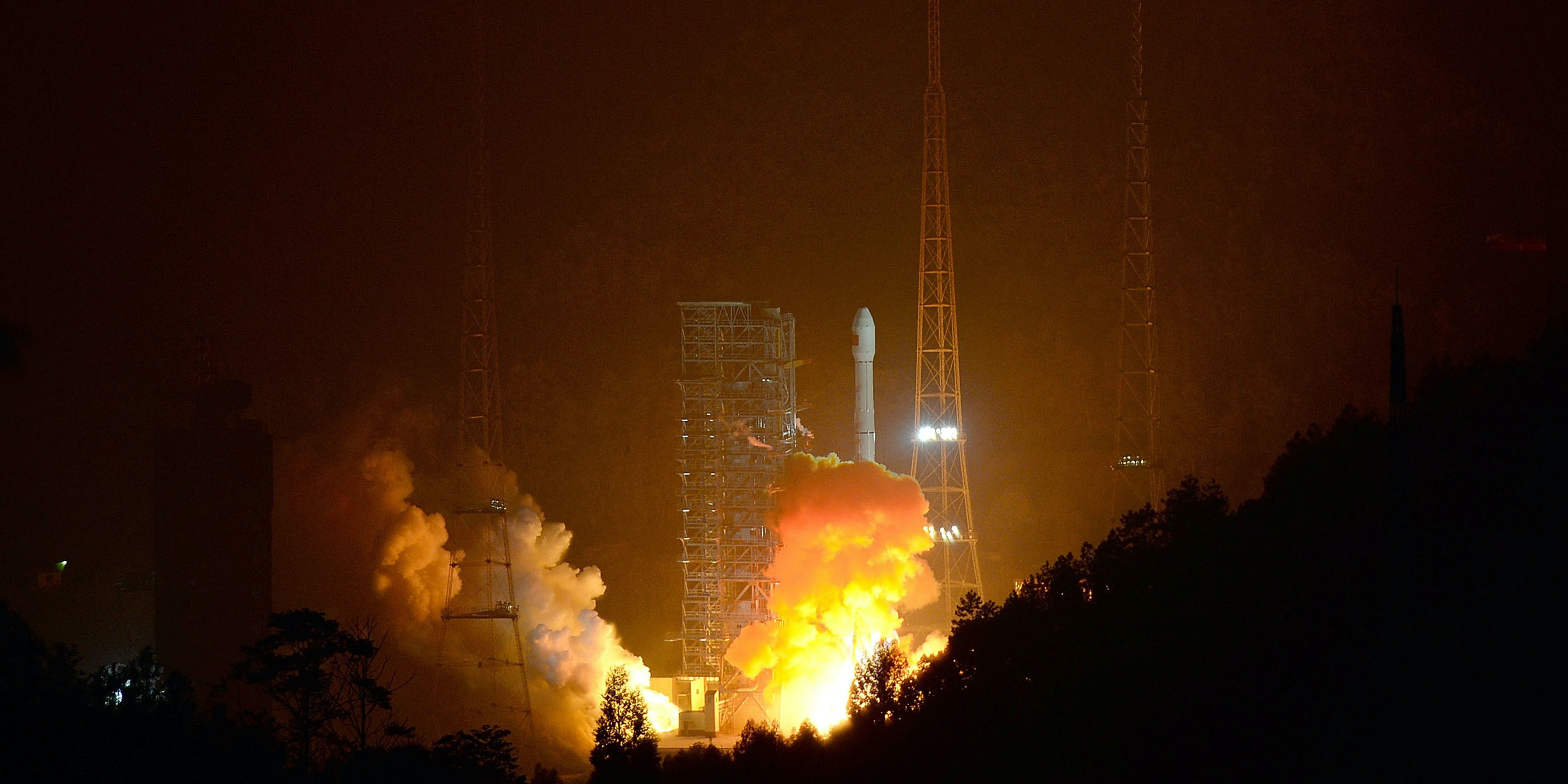 XICHANG, CHINA - DECEMBER 02:  (CHINA OUT) A Long March-3B carrier rocket carrying China's Chang'e-3 lunar probe takes off from the Xichang Satellite Launch Center on December 2, 2013 in Xichang, China. China successfully sent the Chang'e-3 lunar probe with its first moon rover aboard into orbit on Monday morning.  (Photo by VCG/VCG via Getty Images)