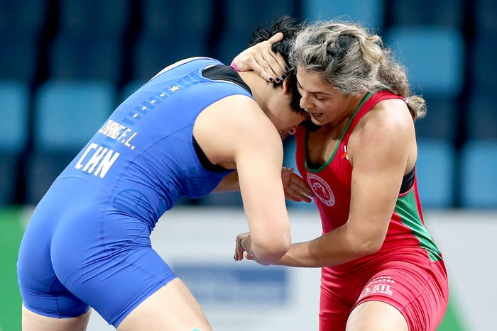 Fengilu Zhang (blue) of China wrestles Keila Cristiana Silva (red) of Brazil during the Women's Wrestling Tournament Test Event for the Rio 2016 Olympics in January.