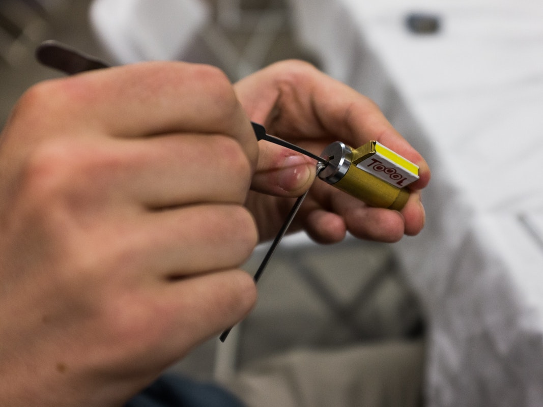 A HOPE attendee picks a TOOOL practice lock, which often come in sets of ascending difficulty (more pins, more problems).