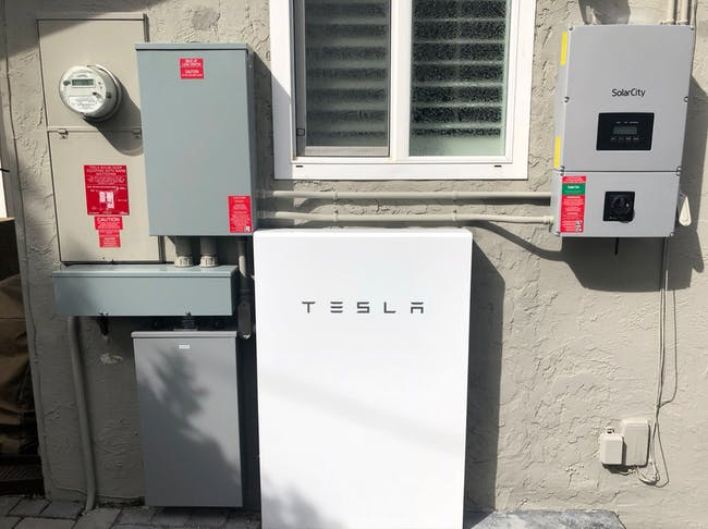 Tobler's Tesla Powerwall on the side of her house.