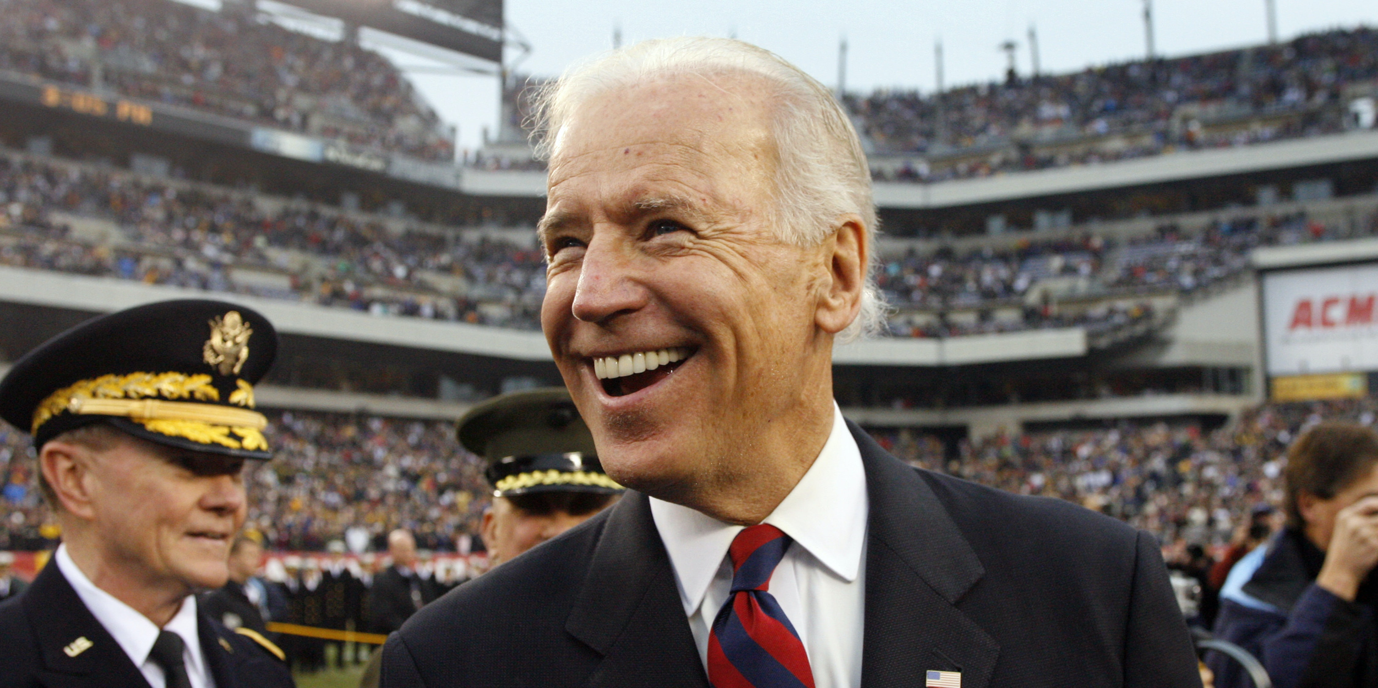 PHILADELPHIA - DECEMBER 8: Vice President of the United States Joe Biden smiles as he stands at midfield during the coin toss before a game between the Army Black Knights and the Navy Midshipmen on December 8, 2012 at Lincoln Financial Field in Philadelphia, Pennsylvania. (Photo by Hunter Martin/Getty Images)