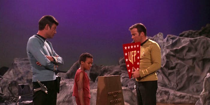 """Kirk and Bones with the flag of the United Federation of Planets in the original 'Star Trek' episode """"And the Children Shall Lead."""""""