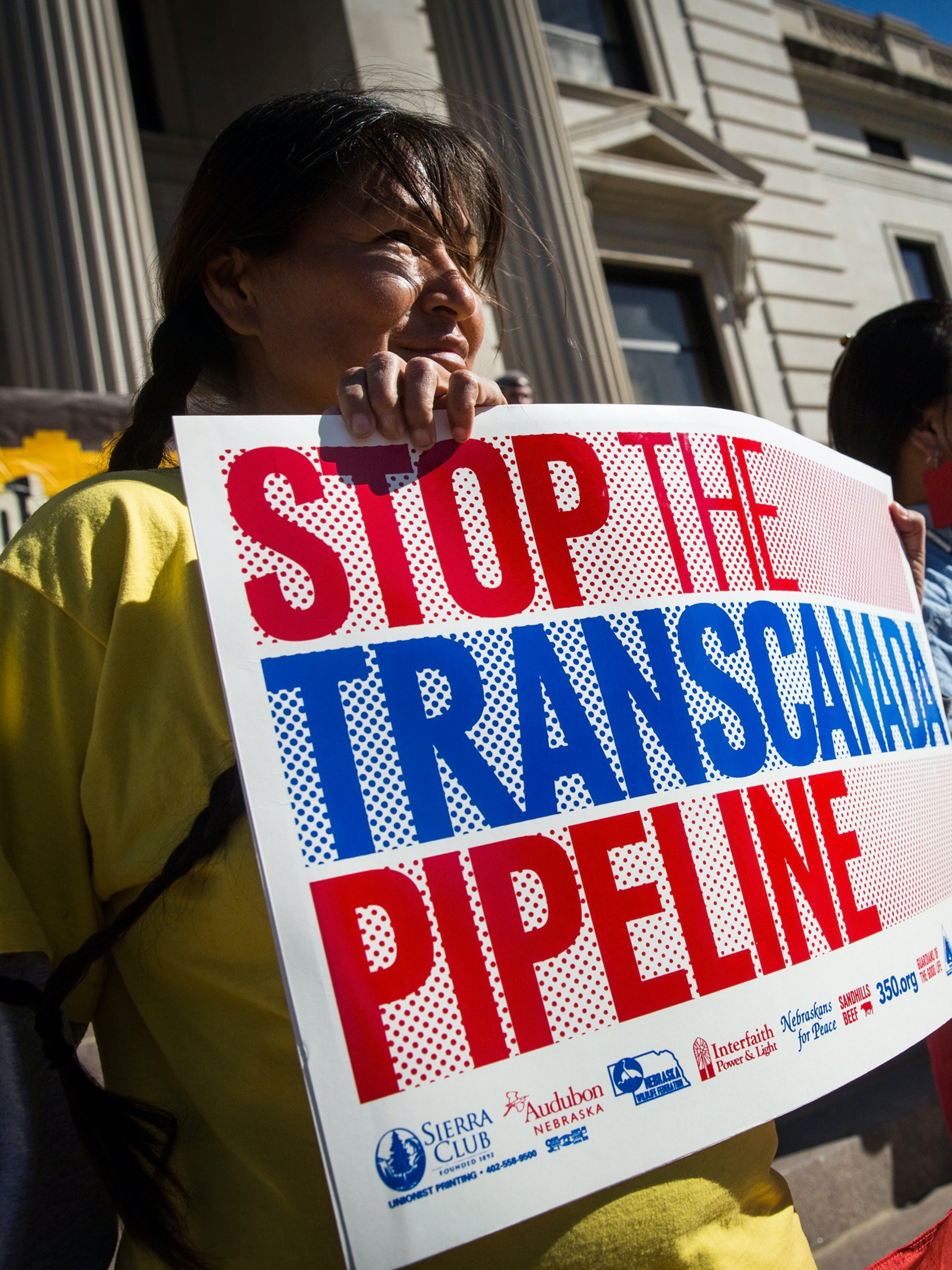 PIERRE, SD - OCTOBER 13:  People participate in a protest against the proposed Keystone XL pipeline on October 13, 2014 in Pierre, South Dakota. Numerous Native American tribes, ranchers, politicians and people against the pipeline came together to hold a rally on the steps of the state's capital building.  (Photo by Andrew Burton/Getty Images)