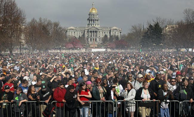 Marijuana smoke rises from a smoking crowd on April 20, 2010, at a pro-pot '4/20' celebration in front of the State Capitol building in Denver, Colorado.