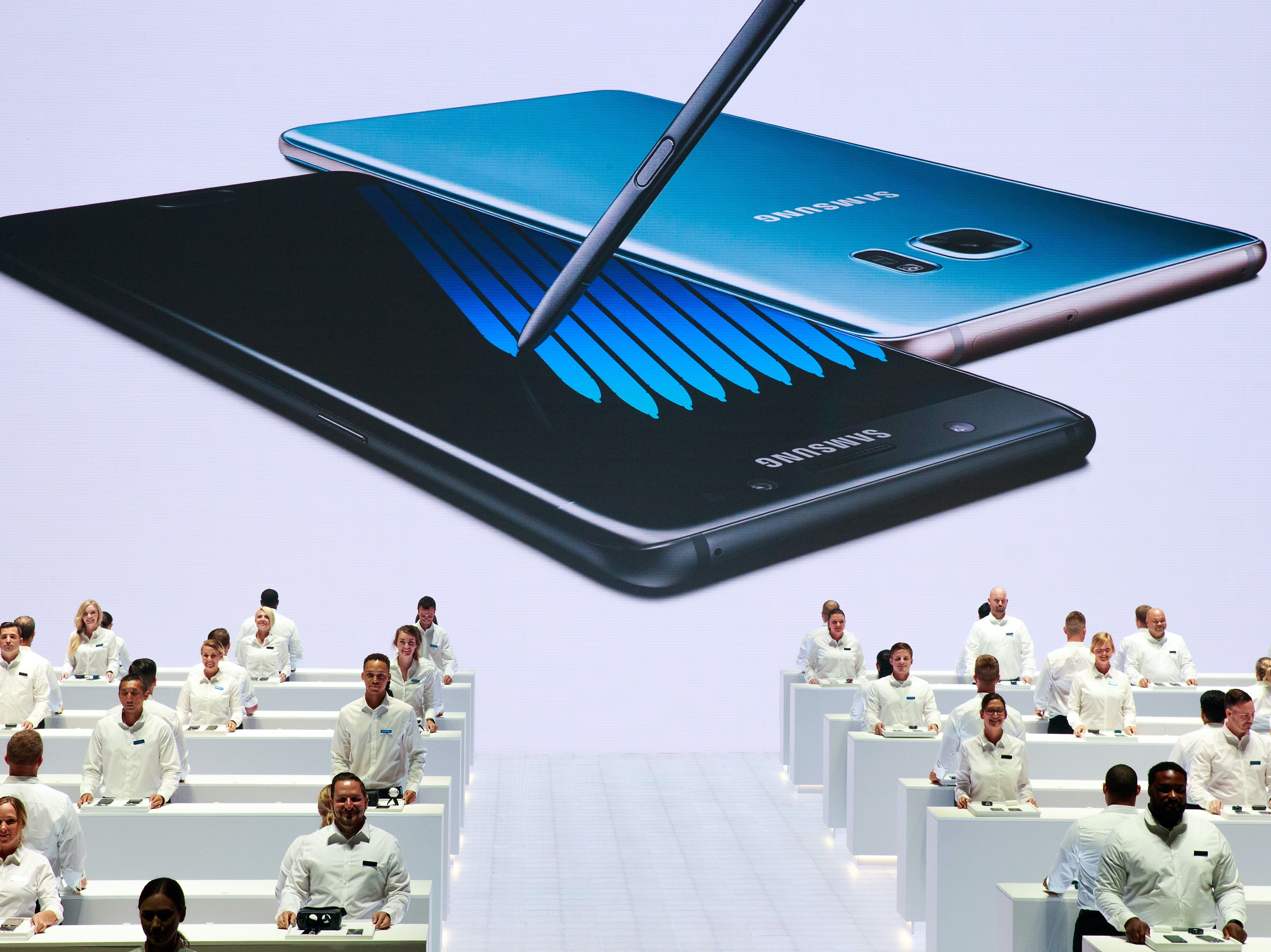 NEW YORK, NY - AUGUST 2: Samsung employees stand at display tables during a launch event for the Samsung Galaxy Note 7 at the Hammerstein Ballroom, August 2, 2016 in New York City. The stylus equipped smartphone will be available starting August 19, with preorders starting August 3. (Photo by Drew Angerer/Getty Images)