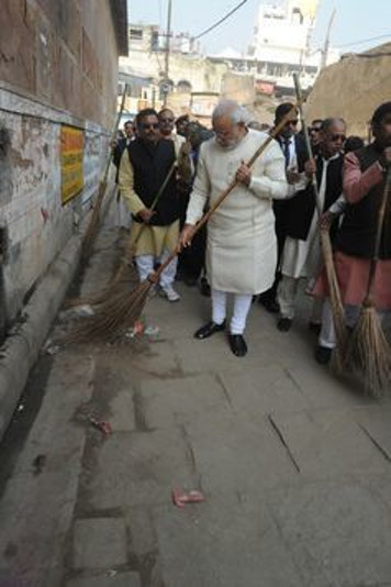 Modi during a cleanliness drive in Assi Ghat Varanasi.