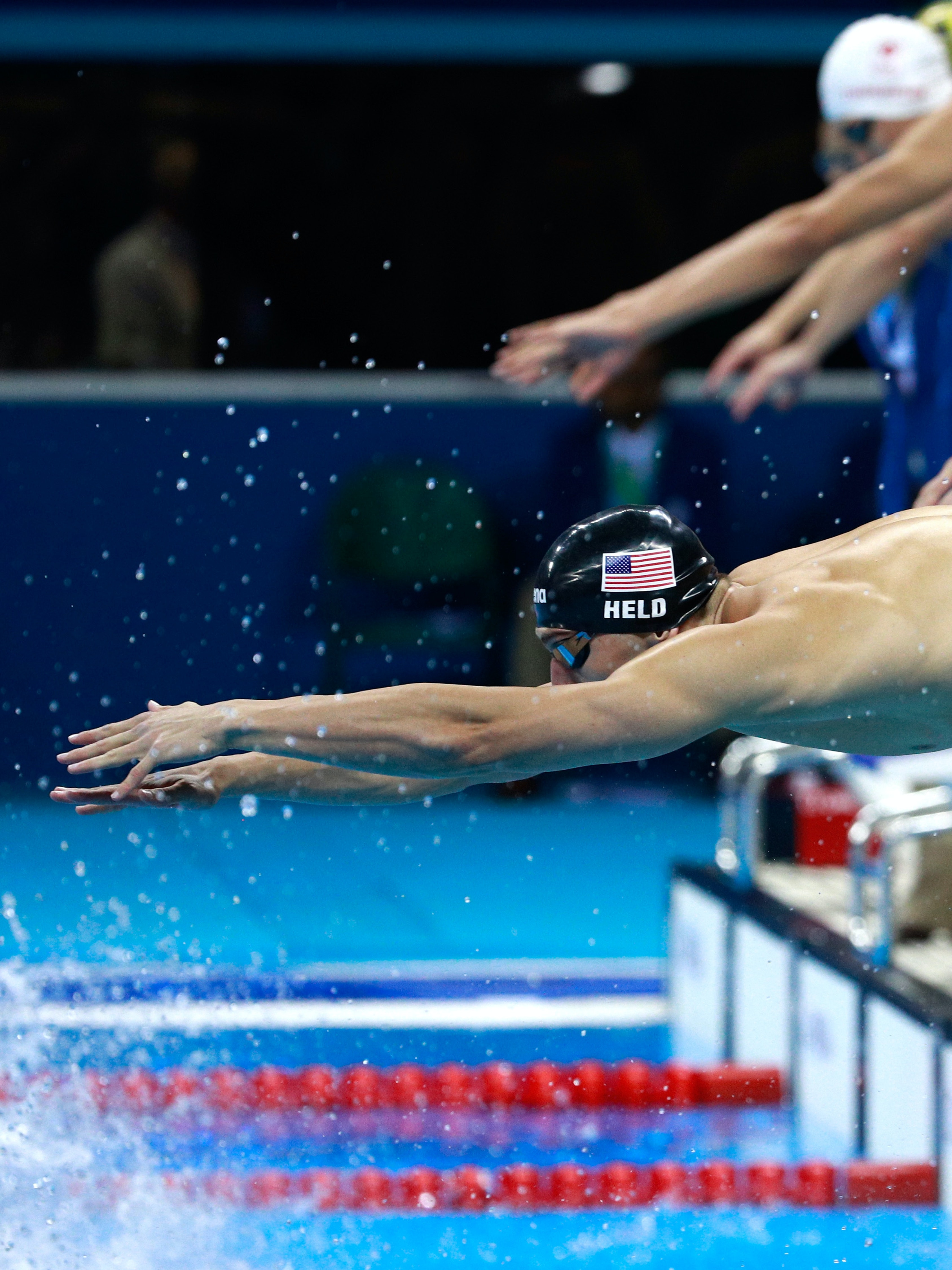 RIO DE JANEIRO, BRAZIL - AUGUST 07:  Ryan Held of the United States competes in the Final of the Men's 4 x 100m Freestyle Relay on Day 2 of the Rio 2016 Olympic Games at the Olympic Aquatics Stadium on August 7, 2016 in Rio de Janeiro, Brazil.  (Photo by Adam Pretty/Getty Images)