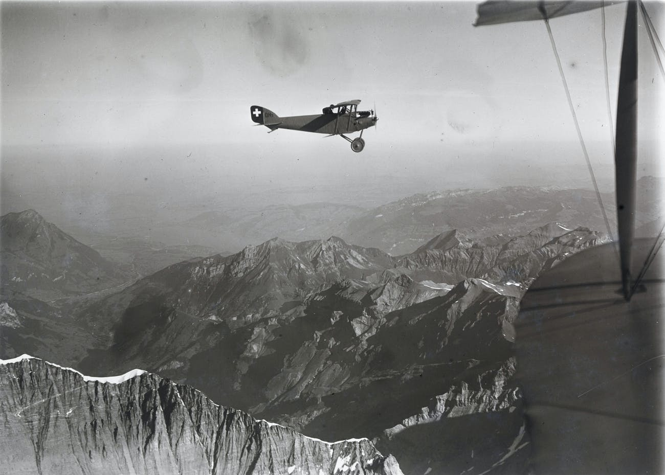 biplane flying over the Alps