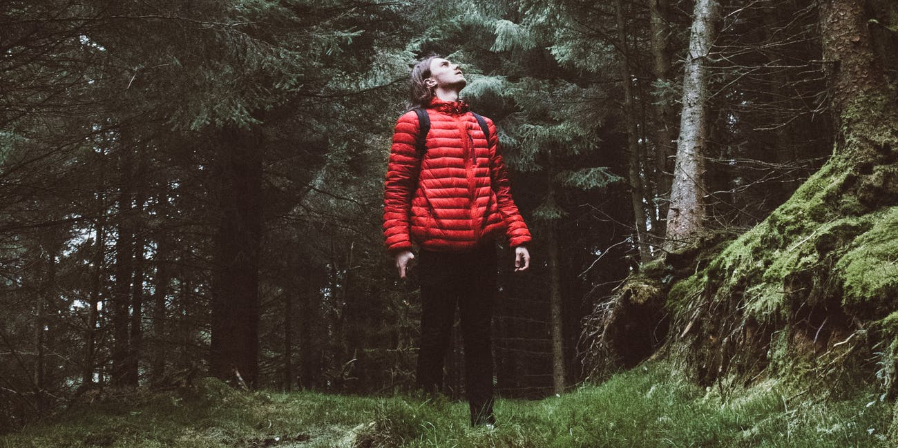 man in red in forest