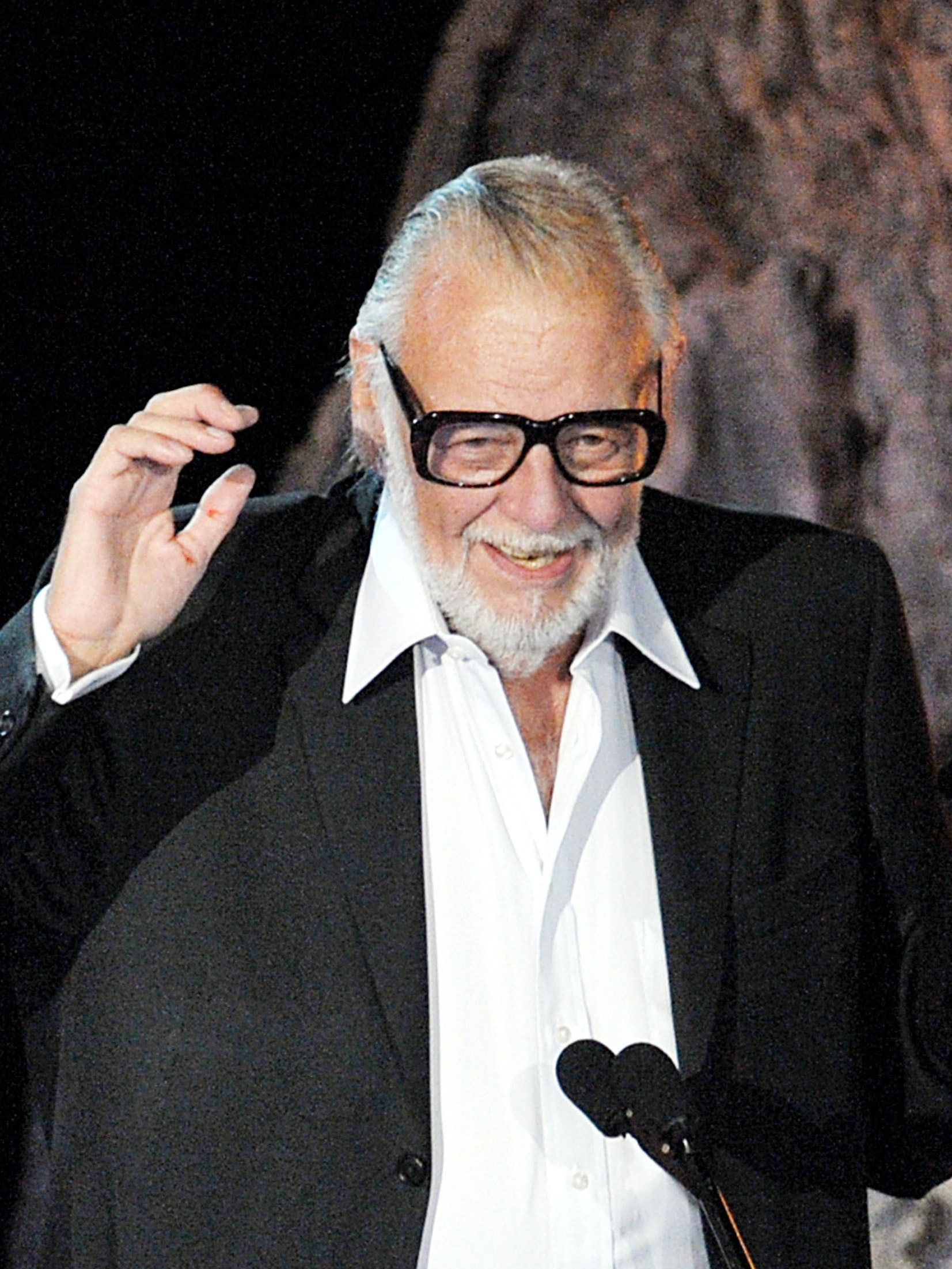 LOS ANGELES, CA - OCTOBER 17:  Director George A. Romero accepts the Mastermind Award onstage during Spike TV's Scream 2009 held at the Greek Theatre on October 17, 2009 in Los Angeles, California.  (Photo by Kevin Winter/Getty Images)