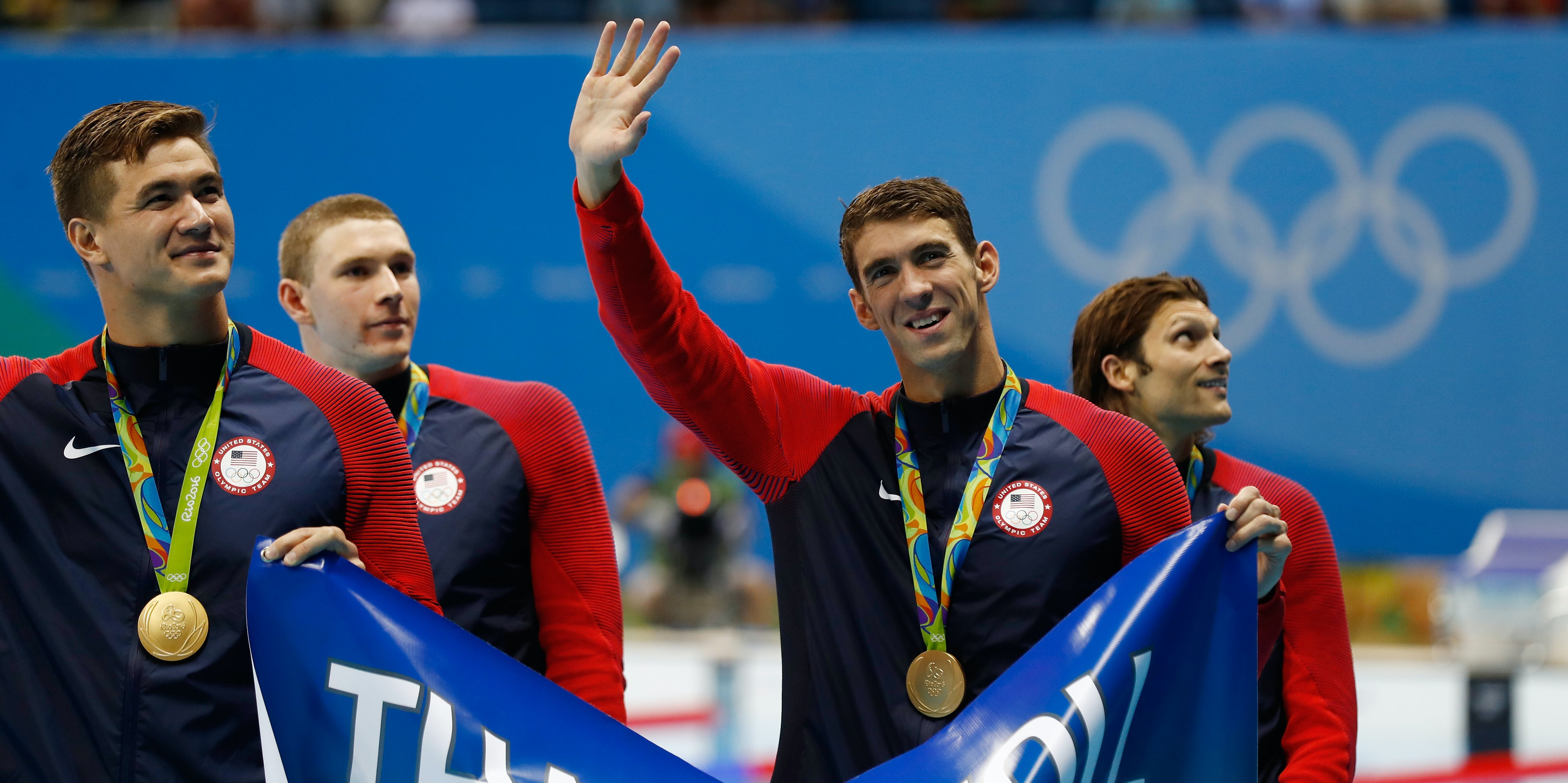 RIO DE JANEIRO, BRAZIL - AUGUST 13:  Gold medalist Michael Phelps of the United States waves to the crowd during the medal ceremony for the Men's 4 x 100m Medley Relay Final on Day 8 of the Rio 2016 Olympic Games at the Olympic Aquatics Stadium on August 13, 2016 in Rio de Janeiro, Brazil.  (Photo by Clive Rose/Getty Images)