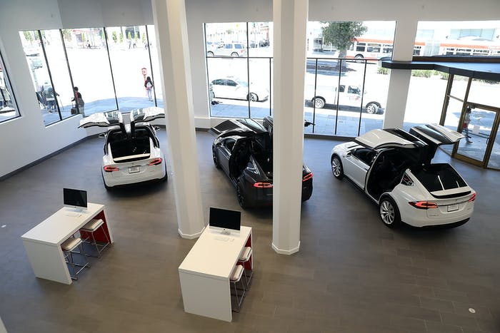 SAN FRANCISCO, CA - AUGUST 10: Three Tesla Model X's are displayed inside of the new Tesla flagship facility on August 10, 2016 in San Francisco, California. Tesla is opening a 65,000 square foot store, its largest retail center to date. The facility will offer sales and service of Tesla's electric car line. (Photo by Justin Sullivan/Getty Images)