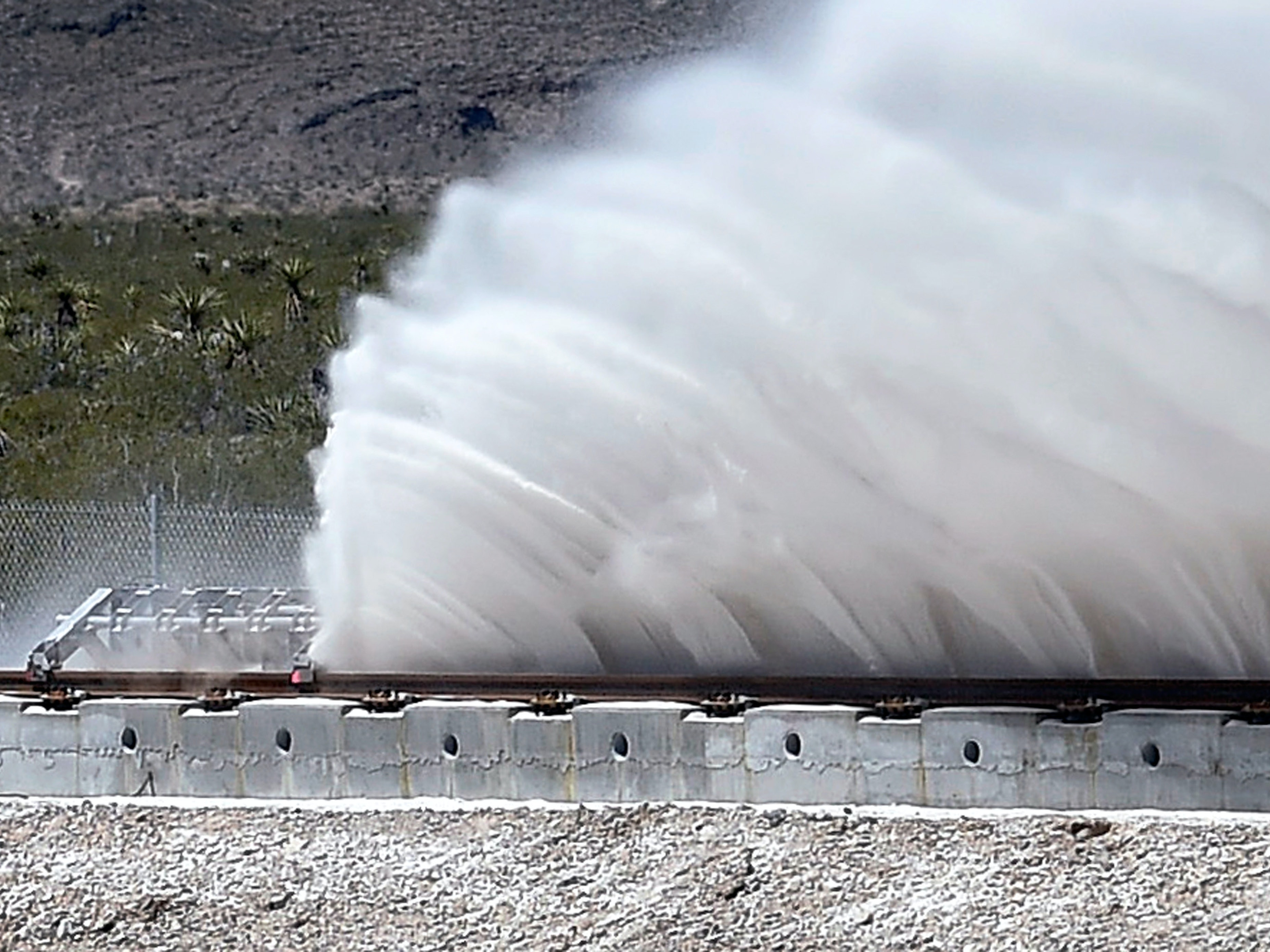 NORTH LAS VEGAS, NV - MAY 11:  Sand is displaced as a test sled is slowed during the first test of the propulsion system at the Hyperloop One Test and Safety site on May 11, 2016 in North Las Vegas, Nevada. The company plans to create a fully operational hyperloop system by 2020.  (Photo by David Becker/Getty Images,)