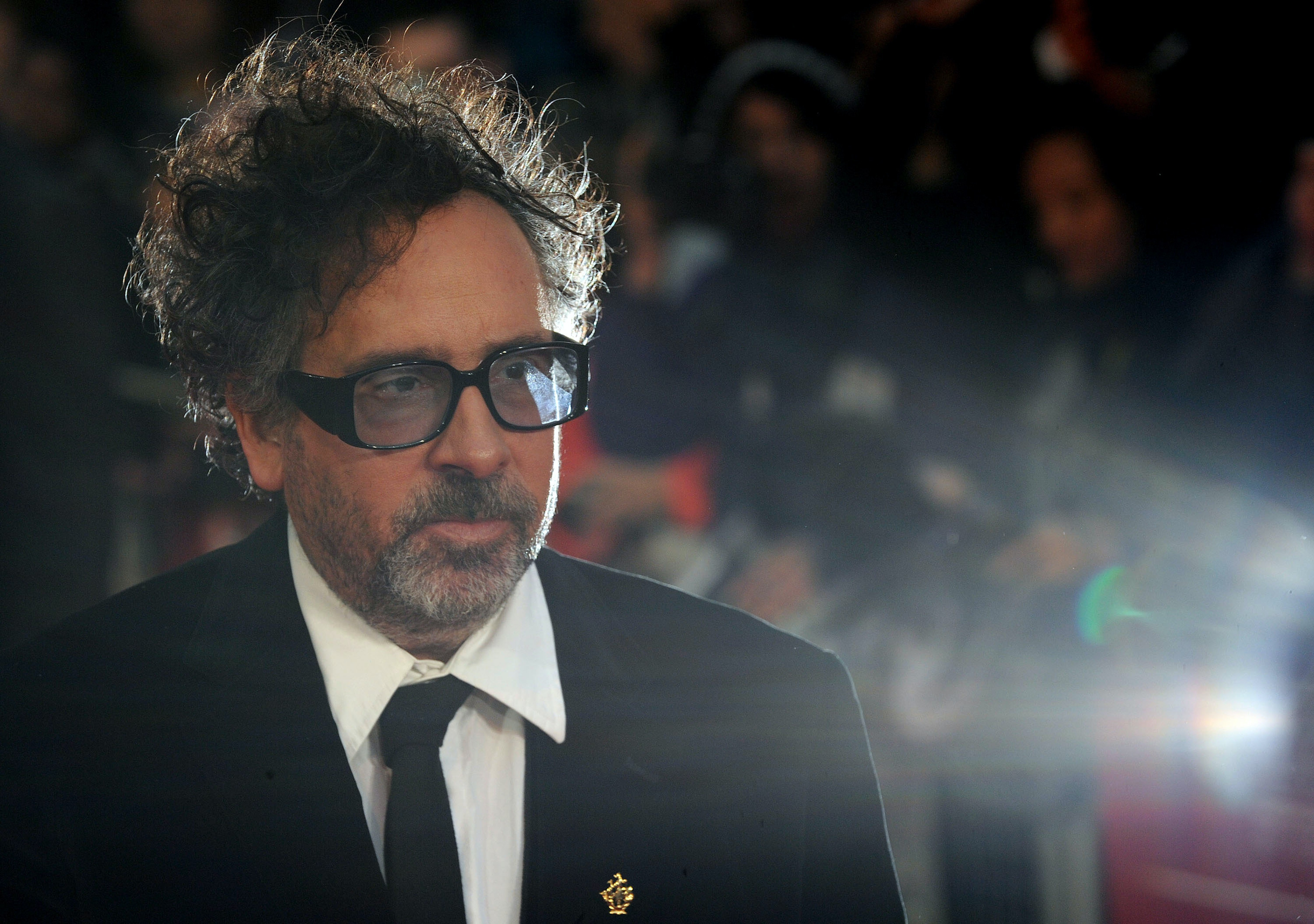 Tim Burton is glowing from his box office win