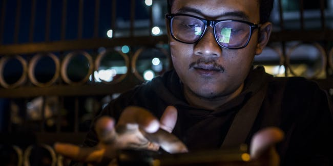 YOGYAKARTA, INDONESIA - JULY 24:  Deni, plays Pokemon Go game on his smartphone on July 24, 2016 in Yogyakarta, Indonesia. 'Pokemon Go,' which uses Google Maps and a smartphone has been a smash-hit in countries where it is available and already popular in Indonesia even though it has not been officially released. Indonesians have been downloading the game by using a proxy location which gives them access to app stores of other countries as security officials have voiced worries that the game could pose a security threat.  (Photo by Ulet Ifansasti/Getty Images)