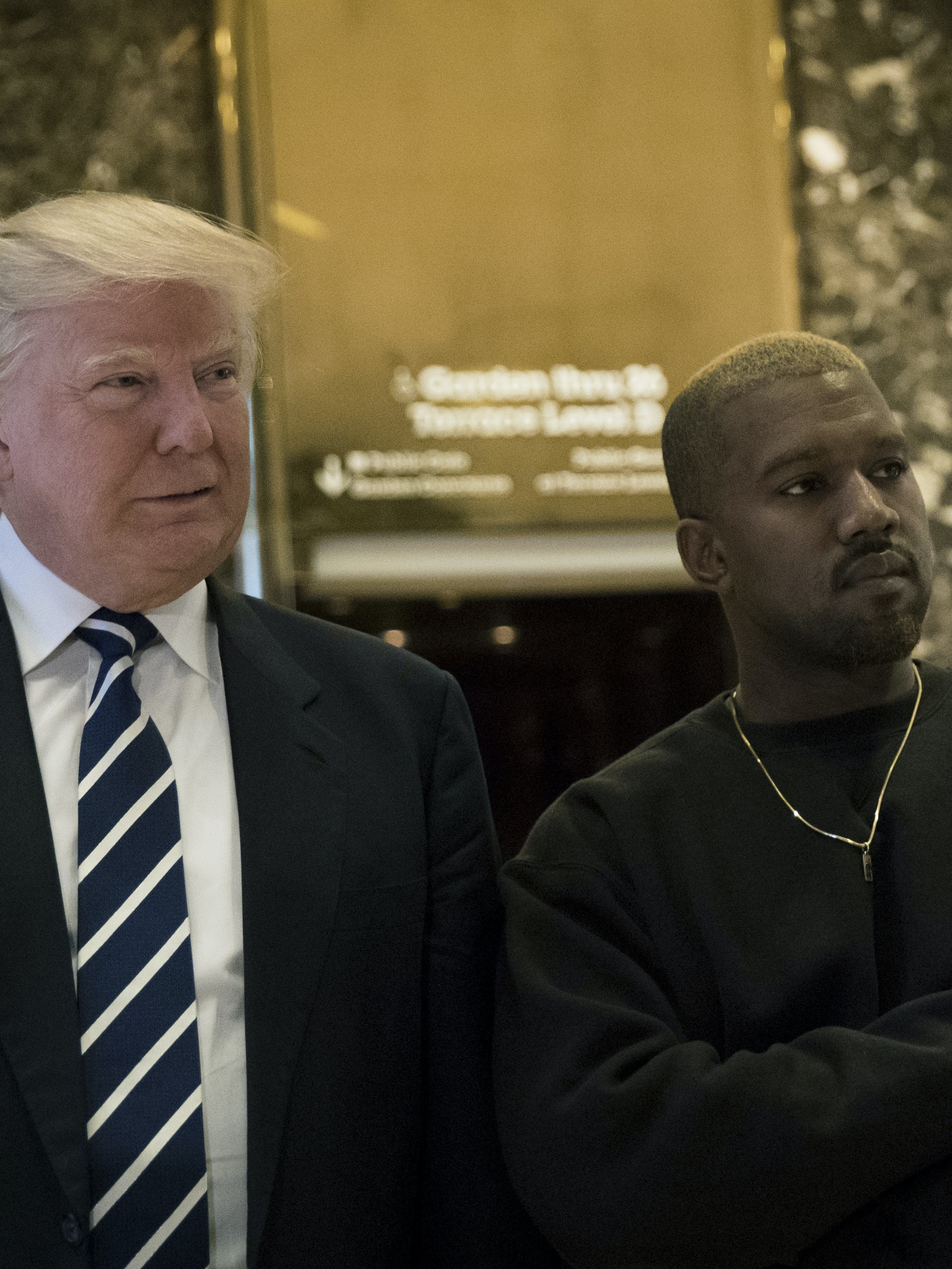 (L to R) President-elect Donald Trump and Kanye West stand together in the lobby at Trump Tower, December 13, 2016 in New York City. President-elect Donald Trump and his transition team are in the process of filling cabinet and other high level positions for the new administration.