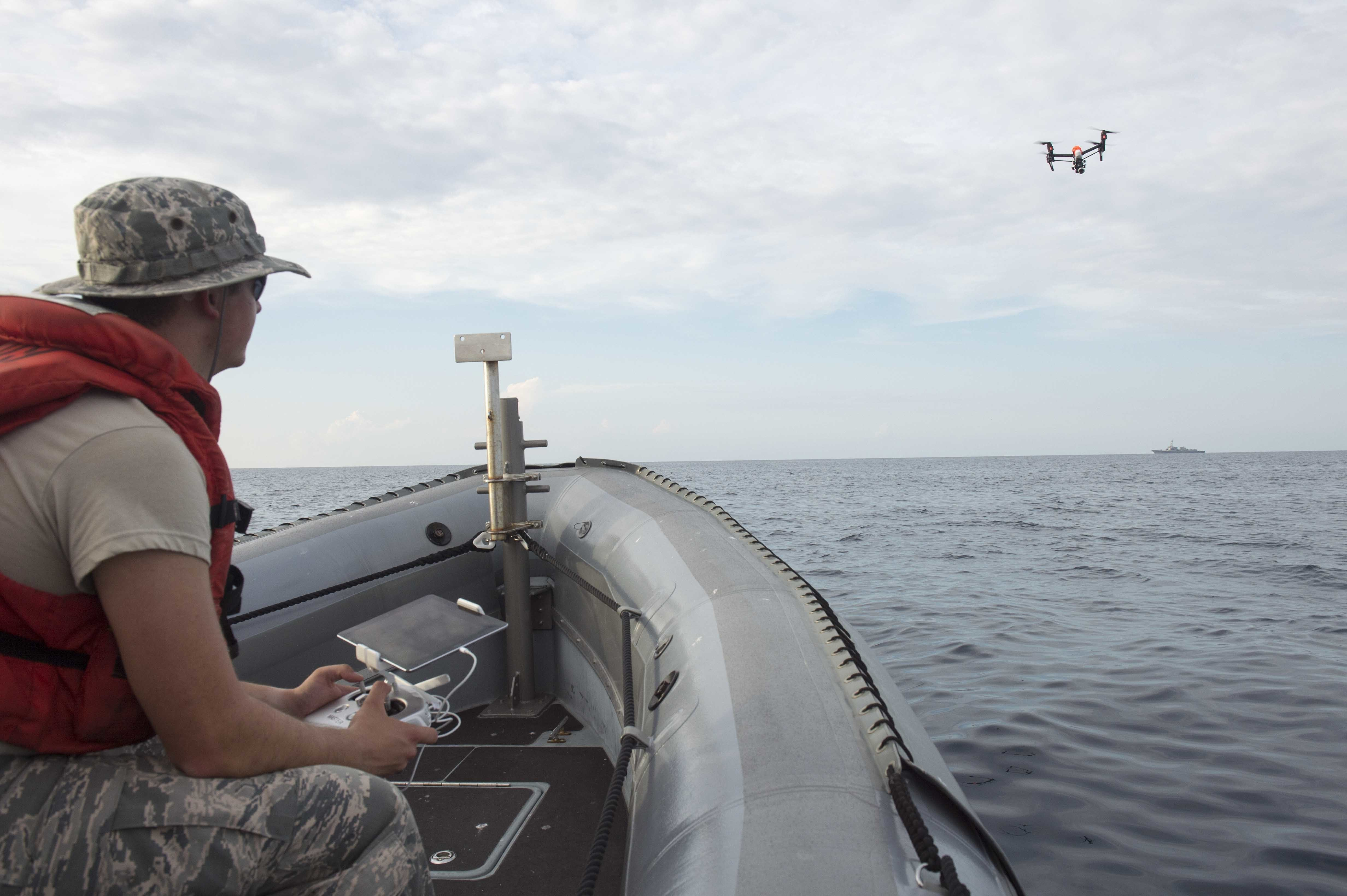 Cadet 1st Class Hanson Oxford, a student at the U.S. Air Force Academy, operates an unmanned aerial system aboard a rigid hull inflatable boat during exercise Black Dart. Black Dart is the largest Department of Defense (DoD) live-fly, live-fire, counter Unmanned Aerial Systems (UAS) technology demonstration.