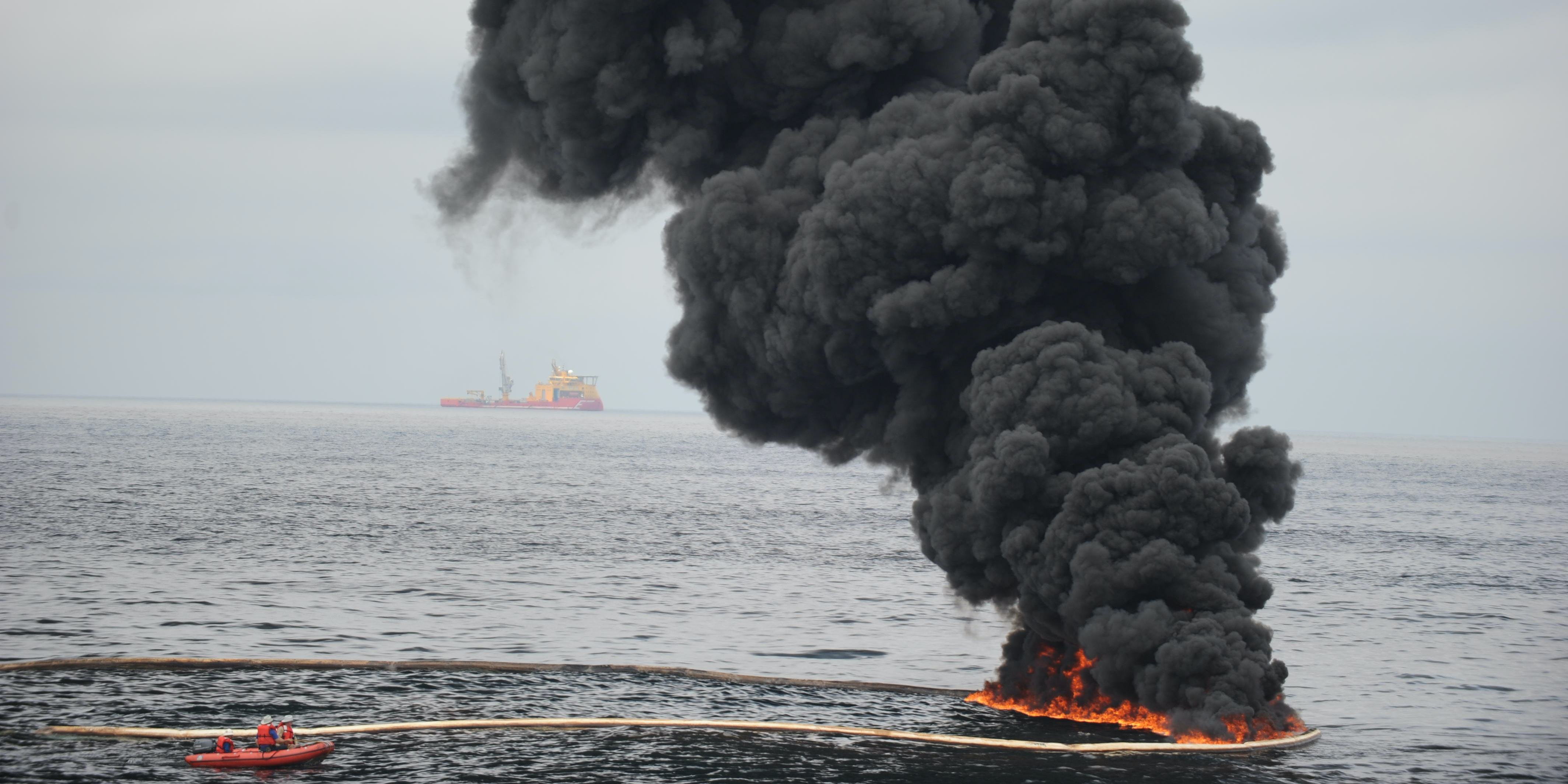 GULF OF MEXICO- MAY 5:  Gathered concentrated oil burns during a controlled oil fire May 5, 2010 in the Gulf of Mexico. The U.S. Coast Guard oversaw the oil burn after the sinking and subsequent massive oil leak because of the sinking of the Deepwater Horizon oil platform off the coast of Louisiana.  (Photo by Justin E. Stumberg/U.S. Navy via Getty Images)