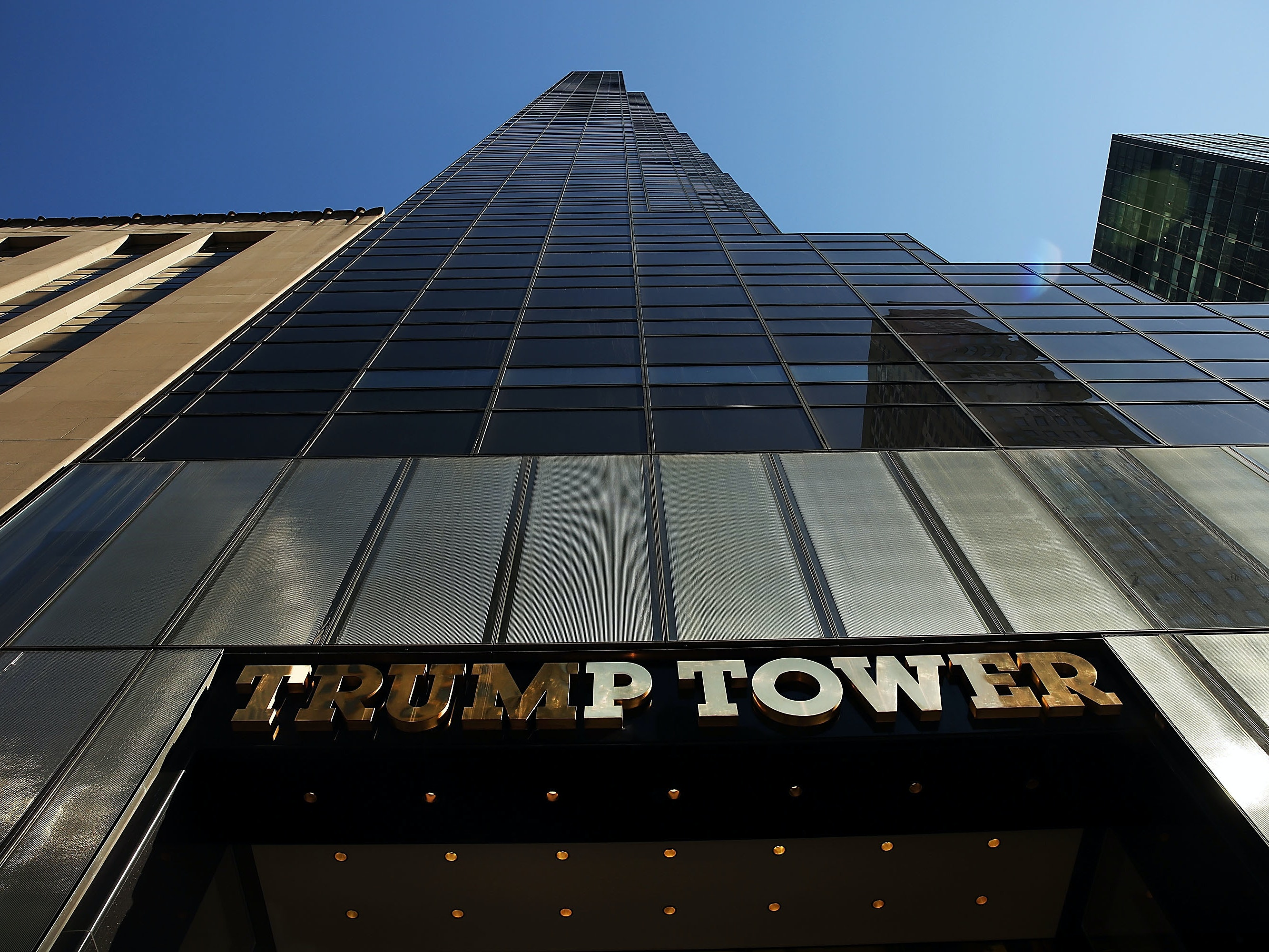 NEW YORK, NY - MARCH 12:  Trump Tower stands along 5th Avenue in Manhattan as police stand guard outside  following an earlier protest against Republican presidential candidate Donald Trump in front of the building on March 12, 2016 in New York City. A member of the New York Police Department (NYPD) stated that the police will now keep an around the clock presence at the location due to the number of protests and threats against Donald Trump.  (Photo by Spencer Platt/Getty Images)