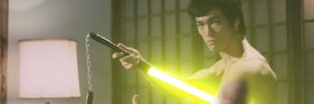 Bruce Lee with nunchuck lightsabers