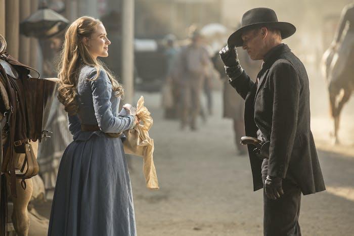 Evan Rachel Wood as Dolores and Ed Harris as The Man in Black