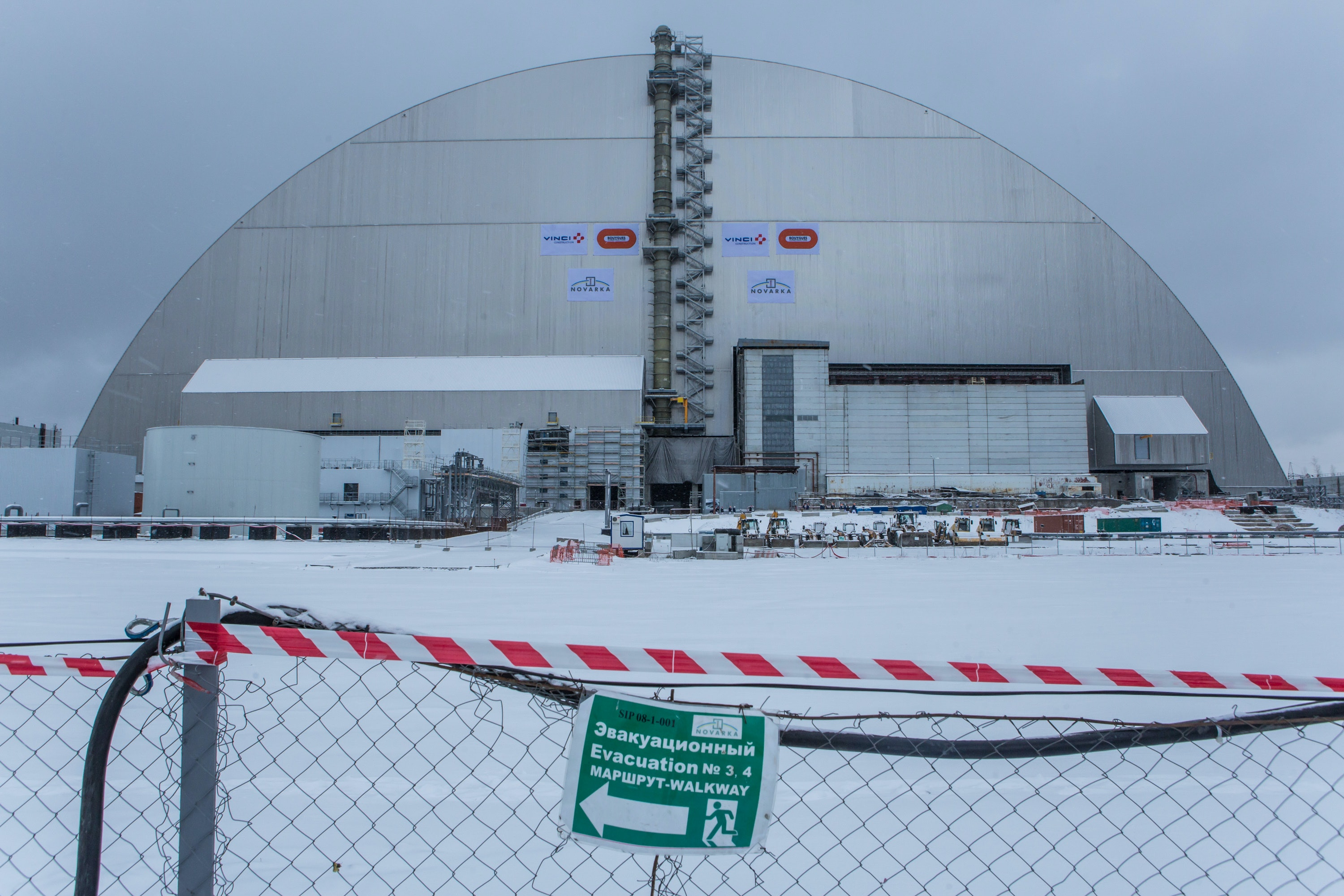CHERNOBYL, UKRAINE - NOVEMBER 29: The New Safe Confinement sarcophagus covers the destroyed reactor number four at the Chernobyl nuclear power station on November 29, 2016 in Chernobyl, Ukraine. On April 26, 1986 workers at the Chernobyl nuclear power plant inadvertantly caused a meltdown in reactor number four, causing it to explode and send a toxic cocktail of radioactive fallout into the atmosphere in the world's worst civilian nuclear incident. (Photo by Brendan Hoffman/Getty Images)