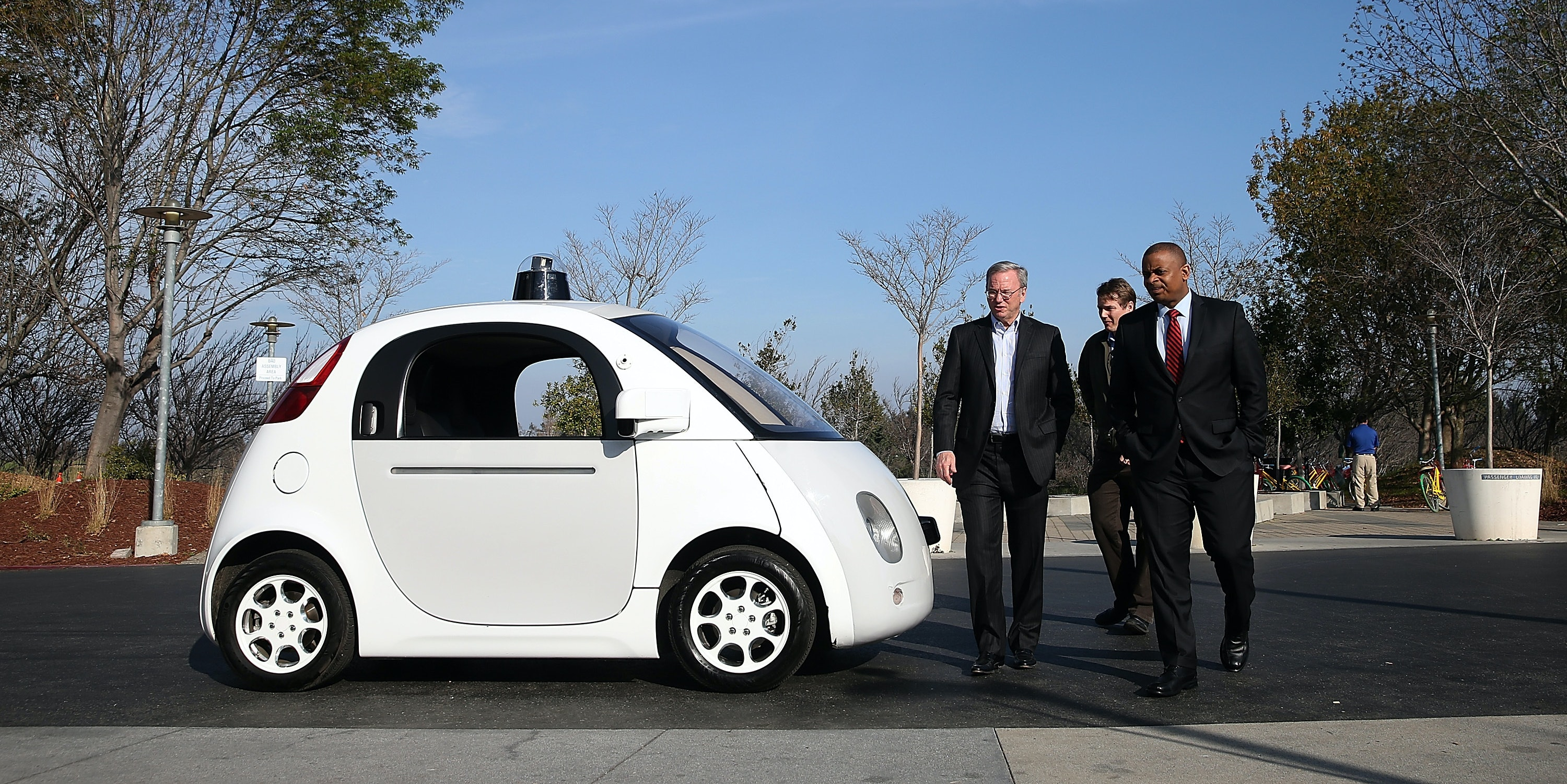 MOUNTAIN VIEW, CA - FEBRUARY 02:  U.S. Transportation Secretary Anthony Foxx (R) and Google Chairman Eric Schmidt (L) walk around a Google self-driving car at the Google headquarters on February 2, 2015 in Mountain View, California.  U.S. Transportation Secretary Anthony Foxx joined Google Chairman Eric Schmidt for a fireside chat where he unveiled Beyond Traffic, a new analysis from the U.S. Department of Transportation that anticipates the trends and choices facing our transportation system over the next three decades.  (Photo by Justin Sullivan/Getty Images)