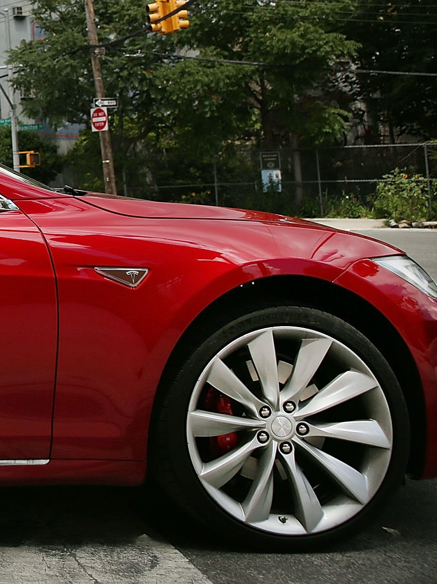 NEW YORK, NY - JULY 05:  A Tesla model S sits parked outside of a new Tesla showroom and service center in Red Hook, Brooklyn on July 5, 2016 in New York City. The electric car company and its CEO and founder Elon Musk have come under increasing scrutiny following a crash of one of its electric cars while using the controversial autopilot service. Joshua Brown crashed and died in Florida on May 7 in a Tesla car that was operating on autopilot, which means that Brown's hands were not on the steering wheel.  (Photo by Spencer Platt/Getty Images)