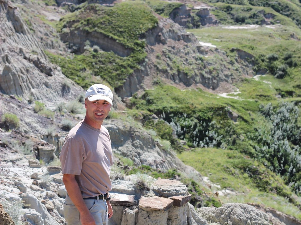 Paleontologist François Therrien overlooks his dig site by the Red Deer River in Alberta.