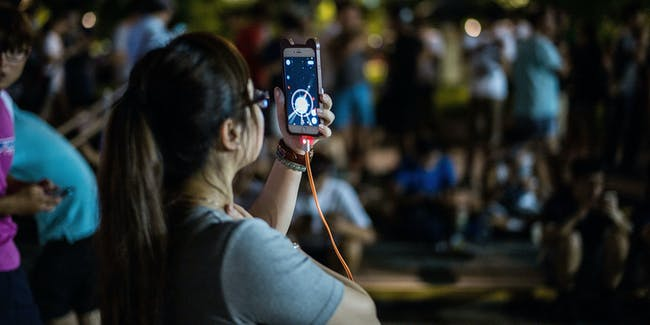 HONG KONG - JULY 26:   People play the Pokemon Go game at a park at Tin Shui Wai on July 26, 2016 in Hong Kong. 'Pokemon Go,' which has been a smash-hit across the globe was launched in Hong Kong on 25th July although shares in Nintendo Co tumbled on Monday after the company said the mobile game would not be a strong earnings driver.   (Photo by Lam Yik Fei/Getty Images)