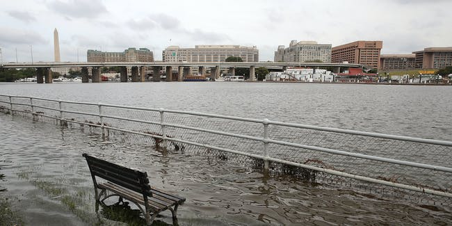 WASHINGTON, DC - SEPTEMBER 20:  A park bench sits in the waters of the Washington Channel during a high tide, September 20, 2016 in Washington, DC. Nussiance high tides have become common place in many east coast cities, and are expected to get worse as the warming climate and melting ice sheets are accelerating the threat to the region's monuments, roads, wildlife refuges.  (Photo by Mark Wilson/Getty Images)