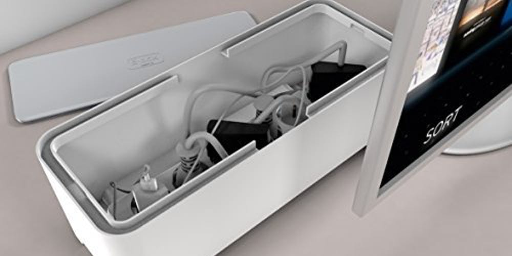 Cable boxes provide storage for cords and power strips.