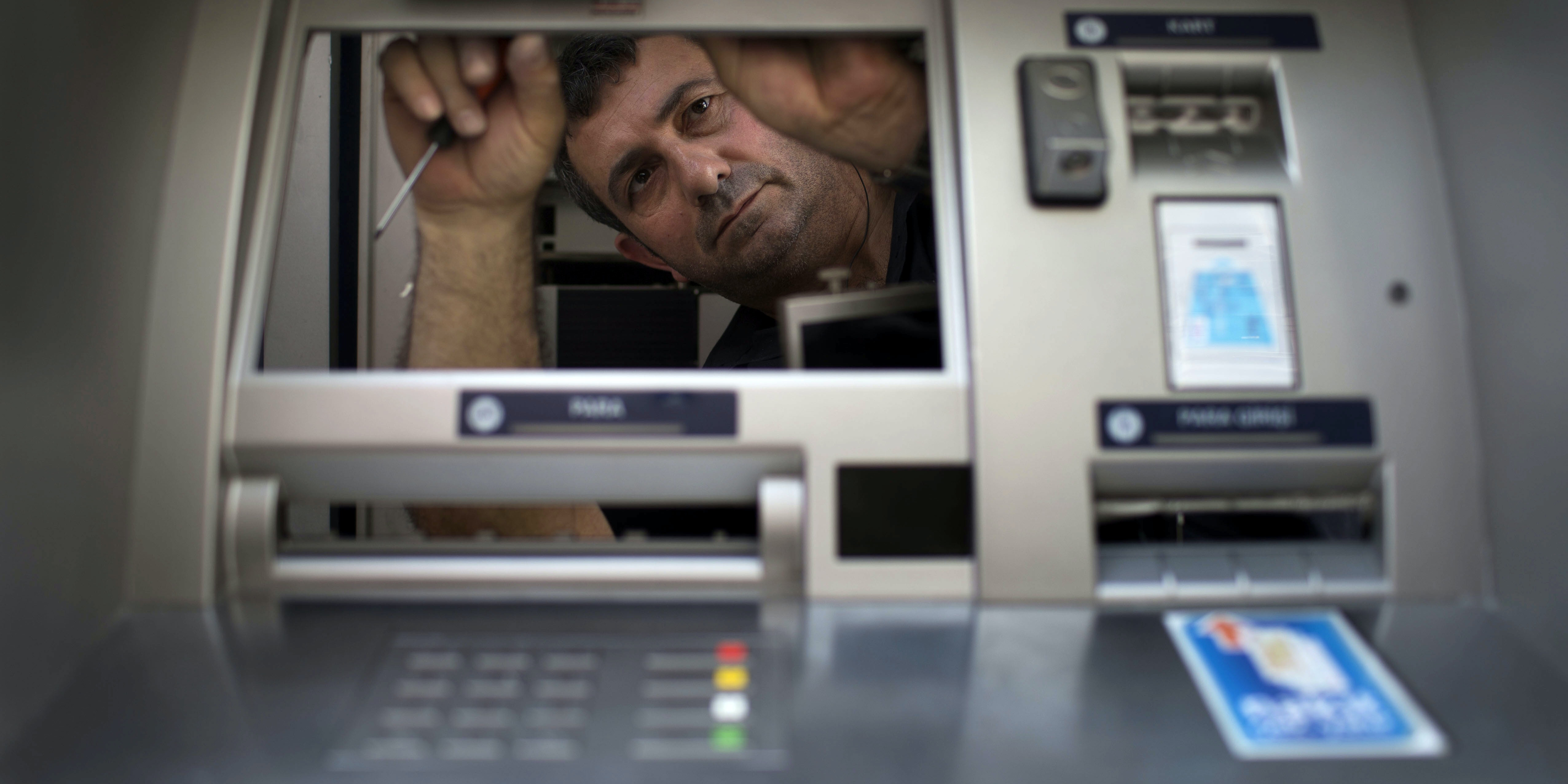 istanbul turkey june 05 technicians fix atm machines that were damaged during riots after anti g jpeg