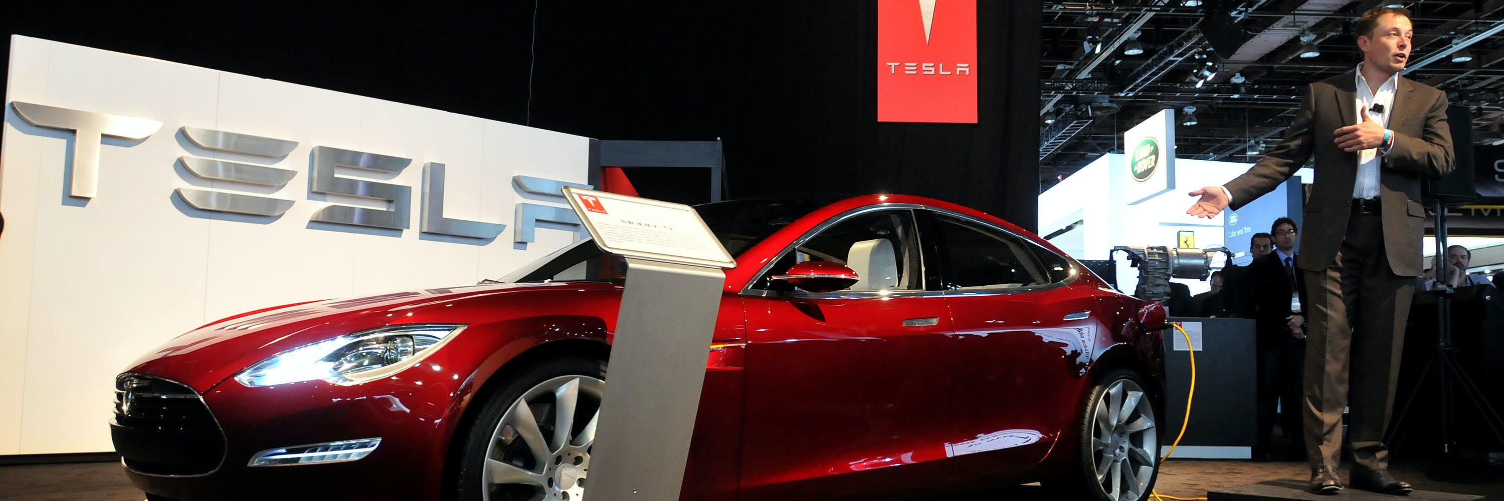 DETROIT -  JANUARY 12:  Elon Musk, Chairman, Product Architect and CEO, Tesla Motors, talks about the Model S electric vehicle during the press preview for the world automotive press at North American International Auto Show in Cobo Center January 12, 2010 in Detroit, Michigan. The 2010 North American International Auto Show (NAIAS) opens to the public January 16th. (Photo by Bryan Mitchell/Getty Images)