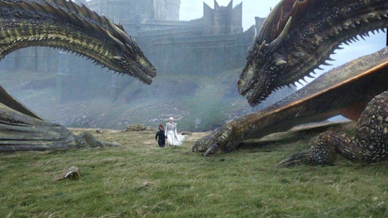 On Dragonstone, Tyrion and Daenerys walk near Rhaegal and Viserion.