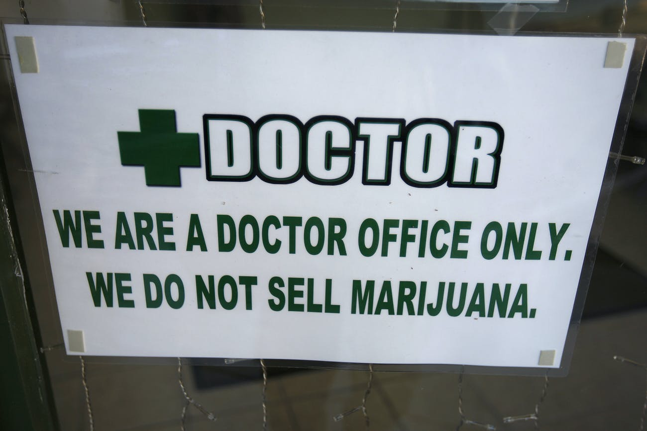 LOS ANGELES, CA - JULY 25: Signage hangs outside +Doctor, a medical marijuana evaluation clinic, which does not distribute marijuana from its facility, is seen on July 25, 2012 in Los Angeles, California. The Los Angeles City Council has unanimously voted to ban storefront medical marijuana dispensaries and to order them to close or face legal action. The council also voted to instruct staff to draw up a separate ordinance for consideration in about three months that might allow dispensaries that existed before a 2007 moratorium on new dispensaries to continue to operate. It is estimated that Los Angeles has about one thousand such facilities. The ban does not prevent patients or cooperatives of two or three people to grow their own in small amounts. Californians voted to legalize medical cannabis use in 1996, clashing with federal drug laws. The state Supreme Court is expected to consider ruling on whether cities can regulate and ban dispensaries. (Photo by David McNew/Getty Images)