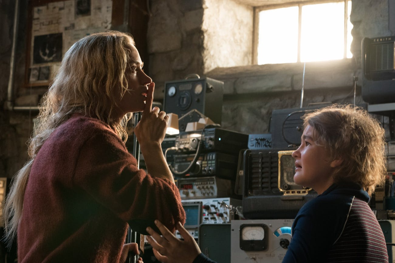Evelyn Abbott (Emily Blunt) and her daughter Regan (Millicent Simmonds) hide from the monsters.