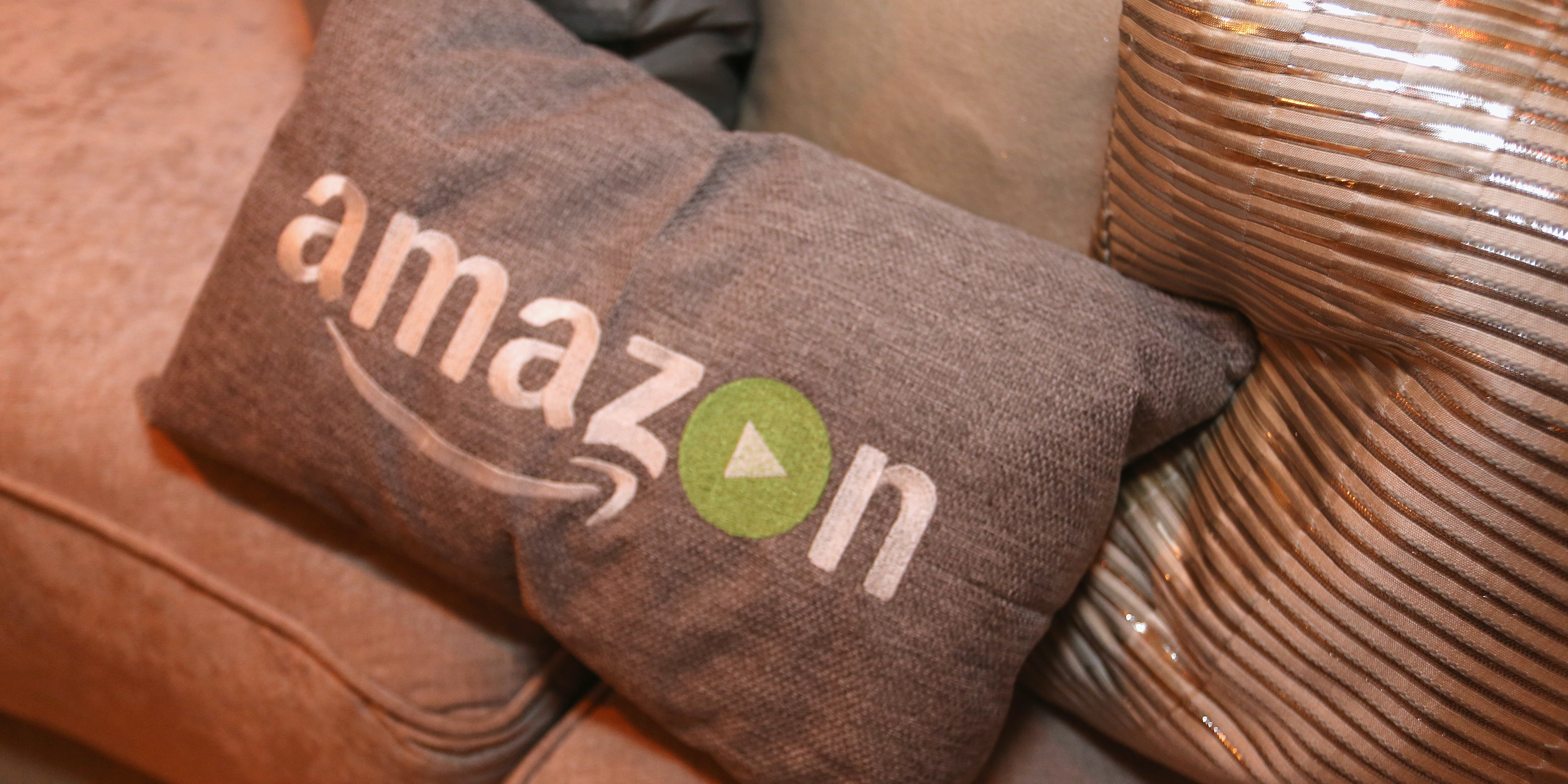 BEVERLY HILLS, CA - JANUARY 10:  Pillows emblazoned with the Amazon logo are displayed at Amazon's Golden Globe Awards Celebration at The Beverly Hilton Hotel on January 10, 2016 in Beverly Hills, California.  (Photo by Rachel Murray/Getty Images for Amazon Studios)